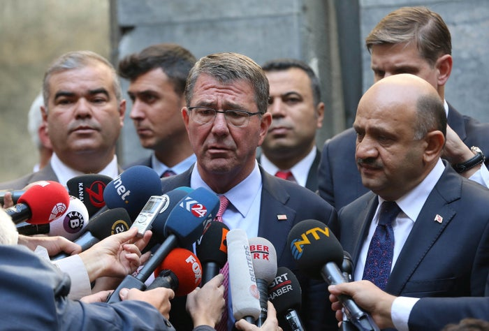 U.S. Defense Secretary Ash Carter, accompanied by Turkey's Defense Minister Fikri Isik (R), talks to media