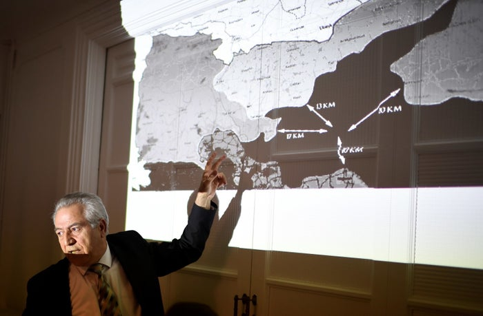 Kurdish Syrian representative in France Khaled Issa shows a map of alleged attacks against Kurdish forces as he accuses Turkey of 'massively attacking' Kurdish forces trying to recapture Raqqa