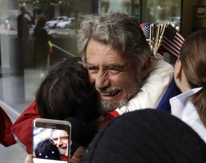 Defendant Neil Wampler is greeted by supporters as he leaves federal court.