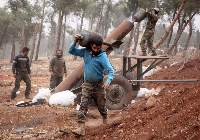 Rebel fighters prepare to fire a home-made mortar.