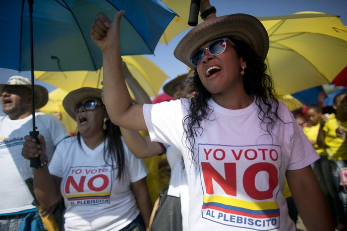 """Demonstrators yell """"No to the plebiscite"""" to protest the government's peace agreement with the Revolutionary Armed Forces of Colombia (FARC) on Sept. 26, 2016."""
