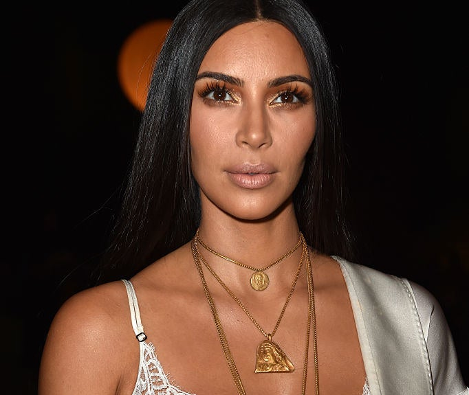 """Two armed men dressed as police officers entered Kim's room and put a gun to her head, according to the Paris prosecutor's office. She was locked in her bathroom while the men robbed two cell phones and millions of dollars worth of jewellery, the French Interior Ministry said.A spokesperson for Kim said Kim had been """"physically unharmed"""" but was left severely """"shaken up""""."""