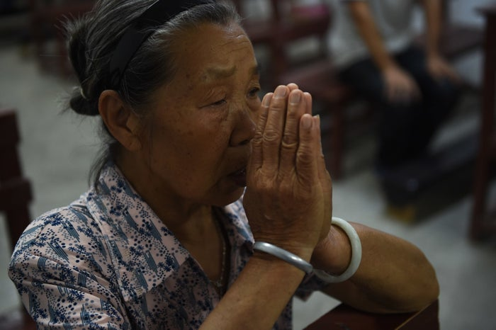A parishioner during a mass at the Catholic church in Dingan, in China's southern Guangxi region