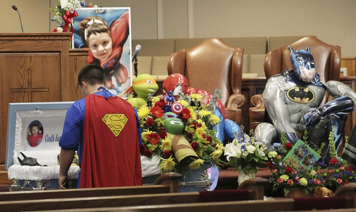 Dale Hall, dressed as Superman, paid his respects to his little brother at the funeral.