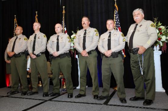 Sgt. Steve Owen, center, in a sheriff's department photo from 2014.