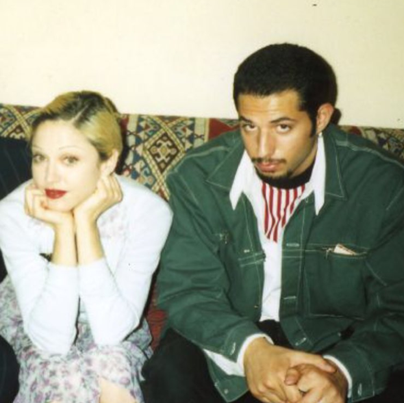 Madonna celebrated the birthday of her manager and friend, Guy Oseary, by throwing it back to the two of them in the mid-'90s.