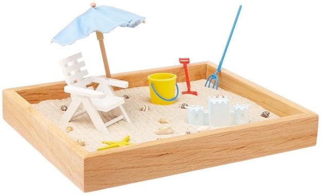 Este pequeño arenero para que no fantasees (tanto) con irte a la playa en horas de oficina ($483).