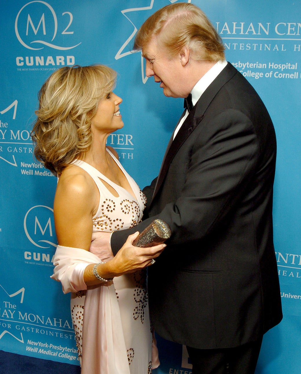 Katie Couric and Donald Trump during Entertainment Industry Foundation's Colon Cancer Benefit in New York City, 2004.