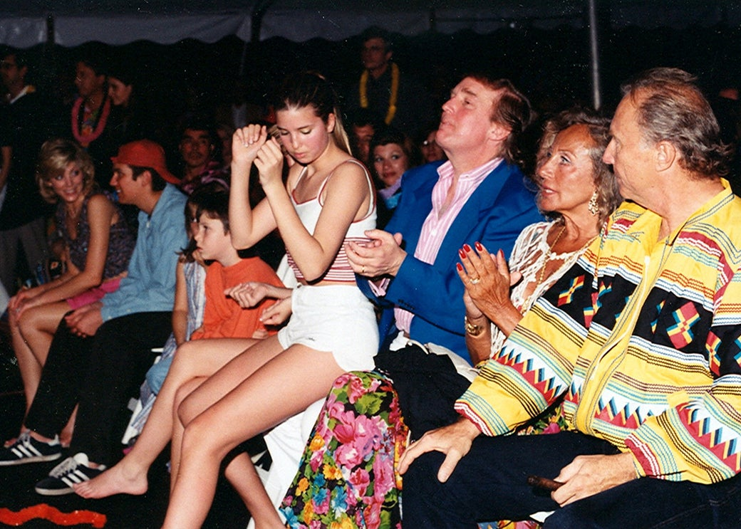 Ivanka Trump (center, in white) sits on her father Donald Trump's lap during a Beach Boys concert at the Mar-a-Lago estate in Palm Beach, Florida, in 1996.