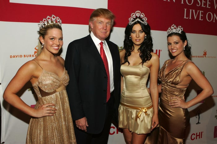 Donald Trump with three beauty queens.
