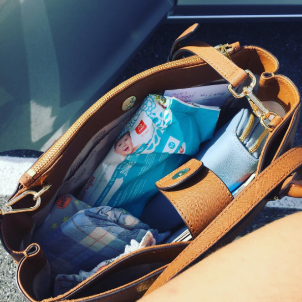 Lipstick and jewelry are replaced by baby wipes and pacifiers in your purse.