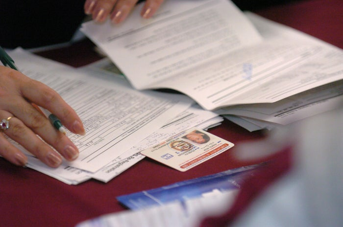 Volunteers and consulate workers help Salvadorians renew Temporary Protective Status (TPS) documentation