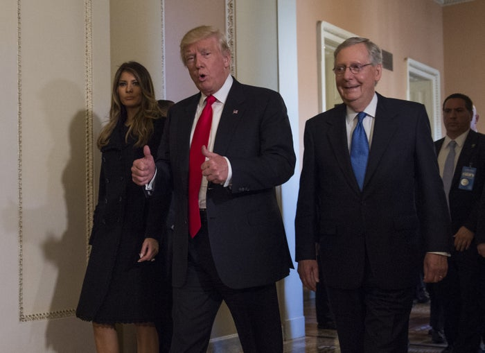 President-elect Donald Trump gives a thumbs-up while walking on Capitol Hill in Thursday.
