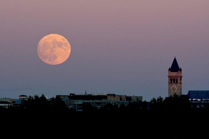 The supermoon rises over Washington, D.C. on Sunday night.