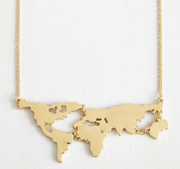 A gold necklace that somehow makes the world seem a lot smaller and more accessible.