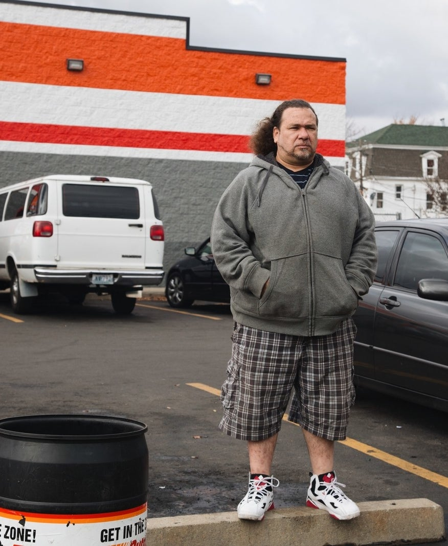 Carlos Carromero in front of the store where he was picked up by police in Providence, Rhode Island.