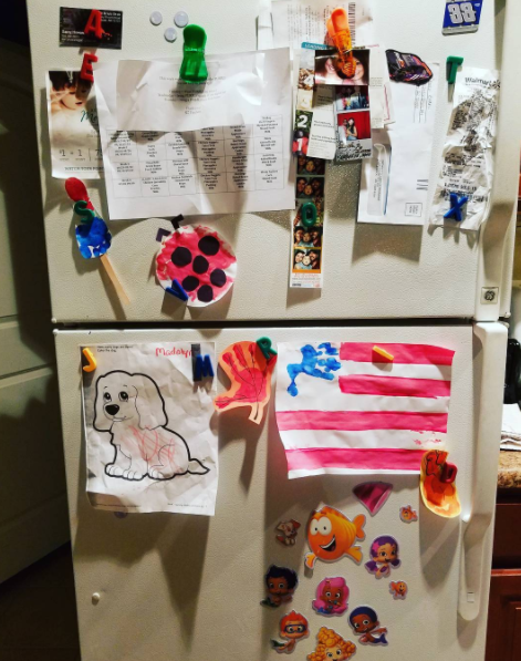 Your fridge turns into a shrine of children's artwork.