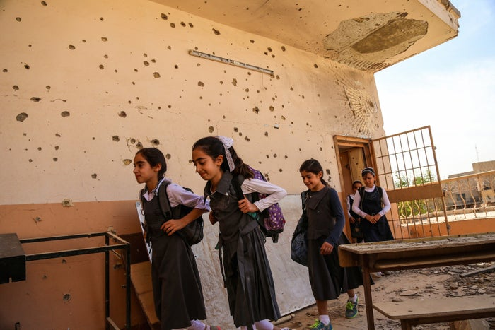 Girls attend a damaged school in Ramadi, Anbar province, Iraq.