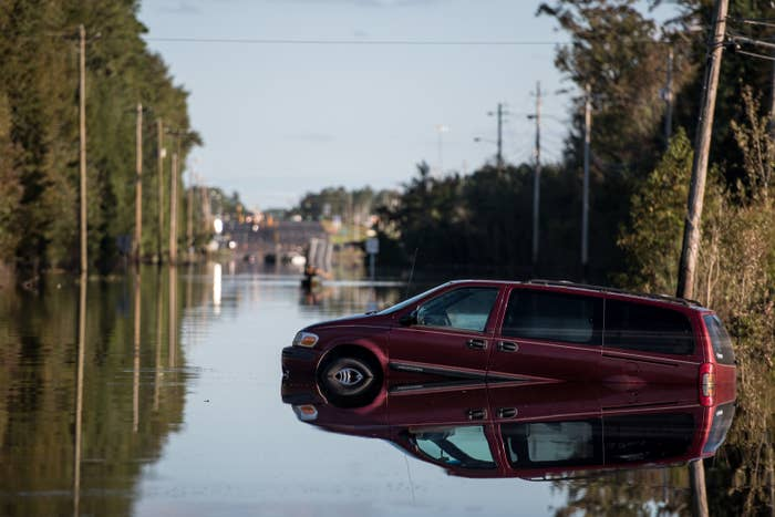 A vehicle partially submerged by floodwaters in Lumberton after Hurricane Matthew.