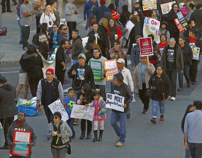 Activists march in rally against the Immigration and Customs Enforcement raids.