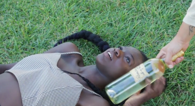 "Selorm chose to re-create the ""bride lying in the grass in a white dress because that makes sense"" photo...with a bottle of wine."
