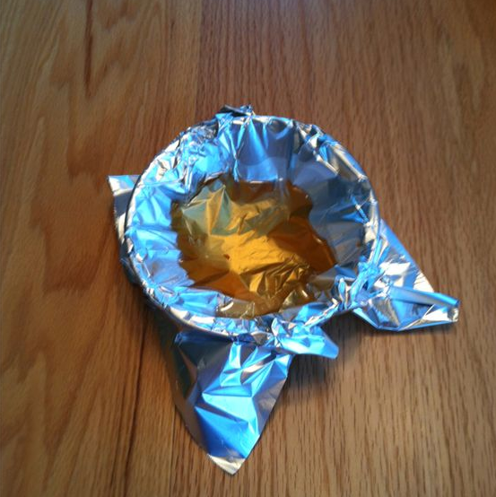 Line a cup with foil before you start cooking, and use it as your grease-dump spot through the whole cooking process.