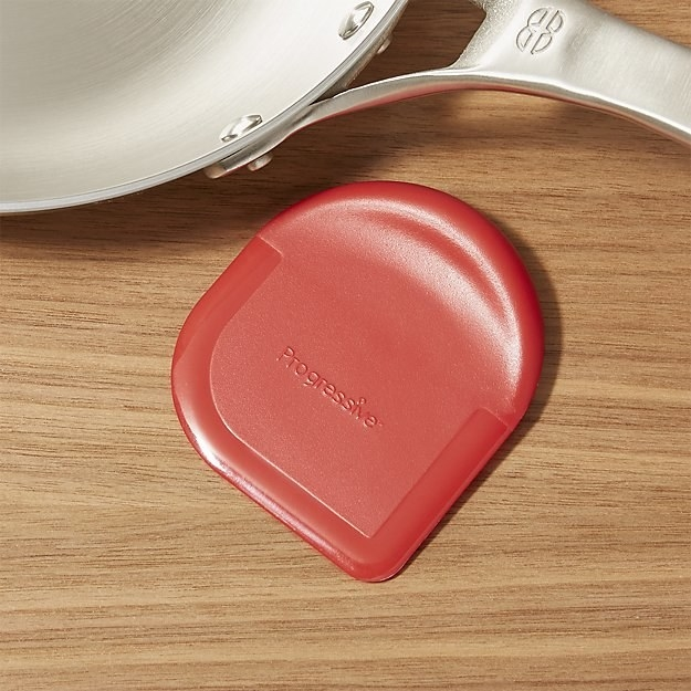Have a plastic pan scraper or some other non-scratch way to clean your pans nearby.