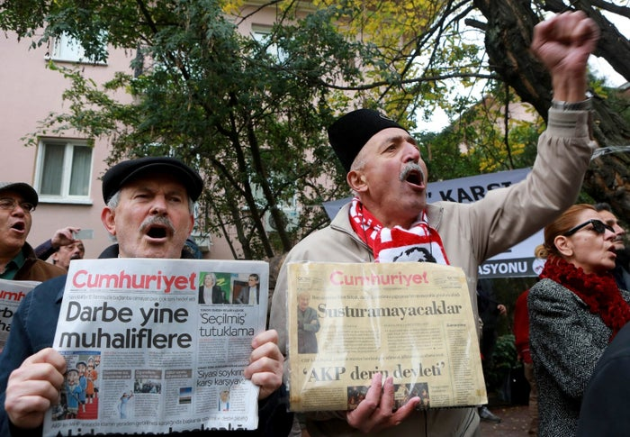 Participants shout slogans outside the headquarters Turkish newspaper Cumhuriyet after the detention of its editor-in-chief.