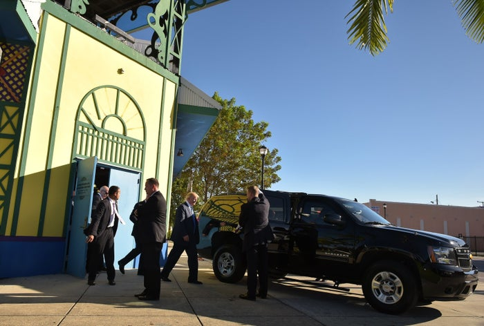 Republican presidential nominee Donald Trump leaves the Little Haiti Cultural Center after a town hall meeting in Miami on Sept. 16, 2016.