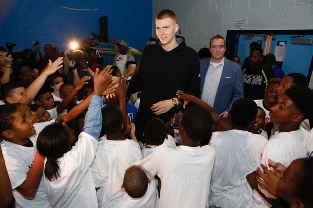 He surprised over 100 inner city kids at the gym in Harlem to kick it all off.