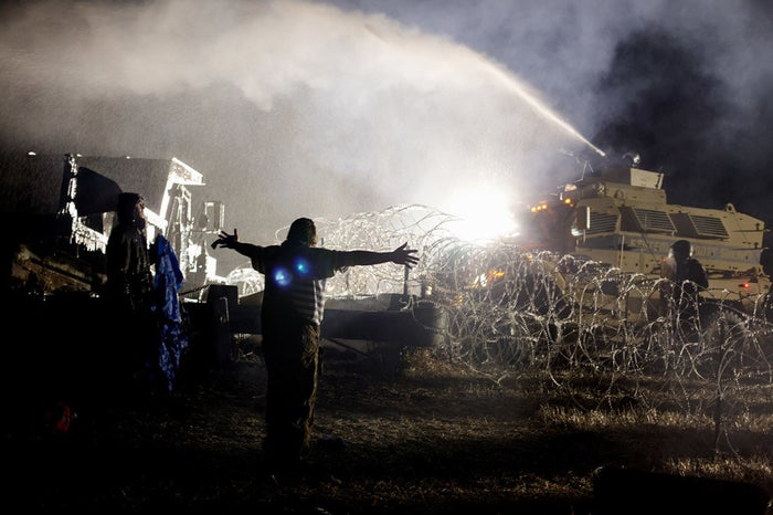 Law enforcement officials used aggressive force on several hundred unarmed protesters, firing rubber bullets, teargas, and water cannons in sub-freezing weather Sunday night. The Standing Rock Medic and Healer Council released a statement saying they had treated 300 injuries, and that ambulances had transported 26 people to local hospitals.