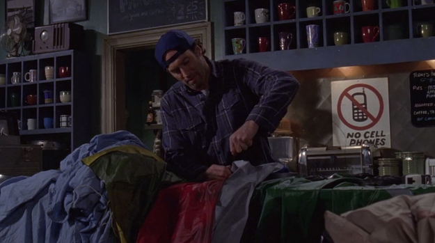 After finding out it's going to rain, he stays up all night and sews a tarp together to cover the whole town and make sure Rory gets her surprise.