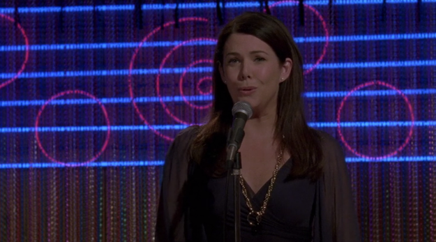 """Lorelai sings """"I Will Always Love You"""" at a karaoke night and Luke walks in in the middle of it."""
