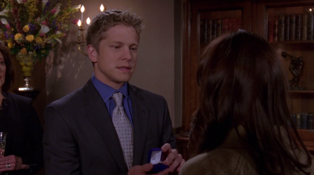 Logan surprises Rory at the graduation party and proposes.