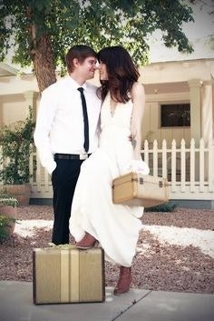 Bo ho chic wedding with the vintage travel case is just adorable for these two newlyweds.