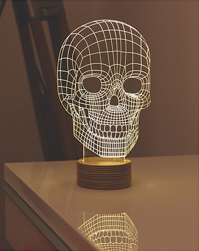 An acrylic and wood skull lamp that has been laser engraved to give an awesome 3D illusion.