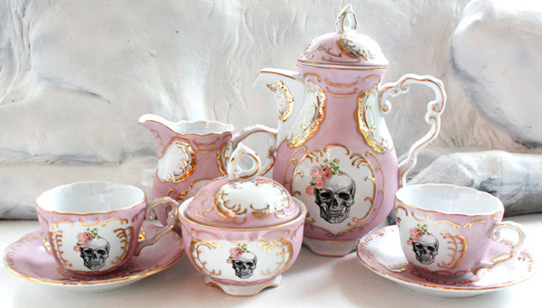 A gorgeous pink, white, and gold rose skull tea set.