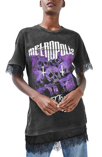 A black and purple T-shirt with a delicate lace hem, and cross and skulls illustration.