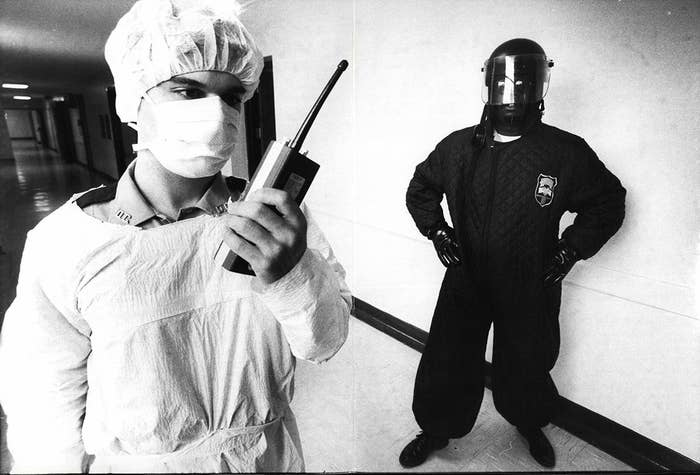 Westchester County correctional officers in New York in charge of inmates in the hospital ward wear special garb due to the uncertainty of AIDS, June 15, 1983.