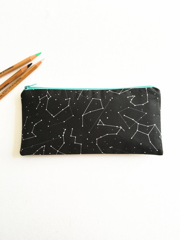 A zodiac-themed zipper pouch to help carry the important stuff.