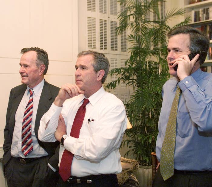 Republican presidential candidate and Texas Gov. George W. Bush (center), his brother, Florida Gov. Jeb Bush (right), and their father, former president George Bush, watch election night results at the governor's mansion in Austin, Nov. 7, 2000.