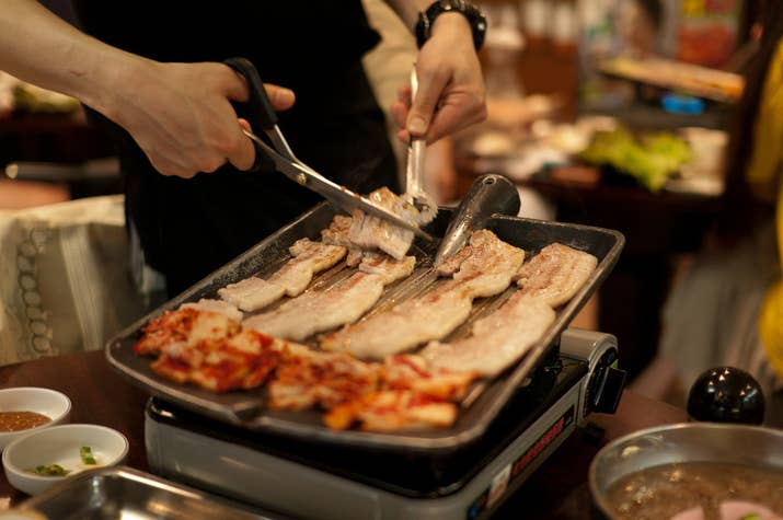 What is it? Thick slices of pork belly.Best enjoyed with a large group of friends, along with many bottles of soju and makgeolli. More serving suggestions here.