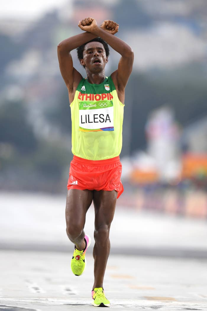Feyisa Lilesa crosses the finish line to win silver during the men's marathon.
