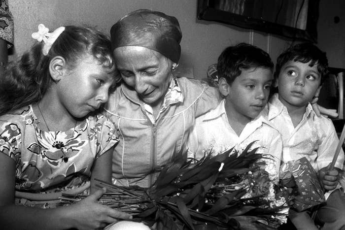 Priscilla Diaz, 36, is reunited with her children Jasmin, 7, and twins Saul and Christian, 5, at her home in the Bronx, New York City. Hospital officials said Diaz contracted HIV from her husband, a drug abuser who had died due to AIDS several months prior.