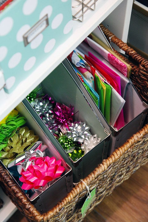 Your bows are always at hand, you can see if you're almost out of paper or tiny bows or whatever, and if you ever needed just the big bows, they'd be easy to pick out from the rest of the bin. Also, magazine organizers are just pretty — like this one at Target, $4.99. Get lots more brilliant DIY gift wrap organizing ideas here.