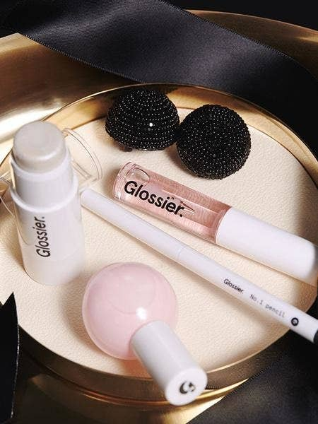 The set includes No. 1 Pencil Eyeliner in Graphite, Haloscope Highlighter in Moonstone, clear lip gloss, and pink nail polish.Get it from Glossier for $50 while supplies last / through the end of 2016.