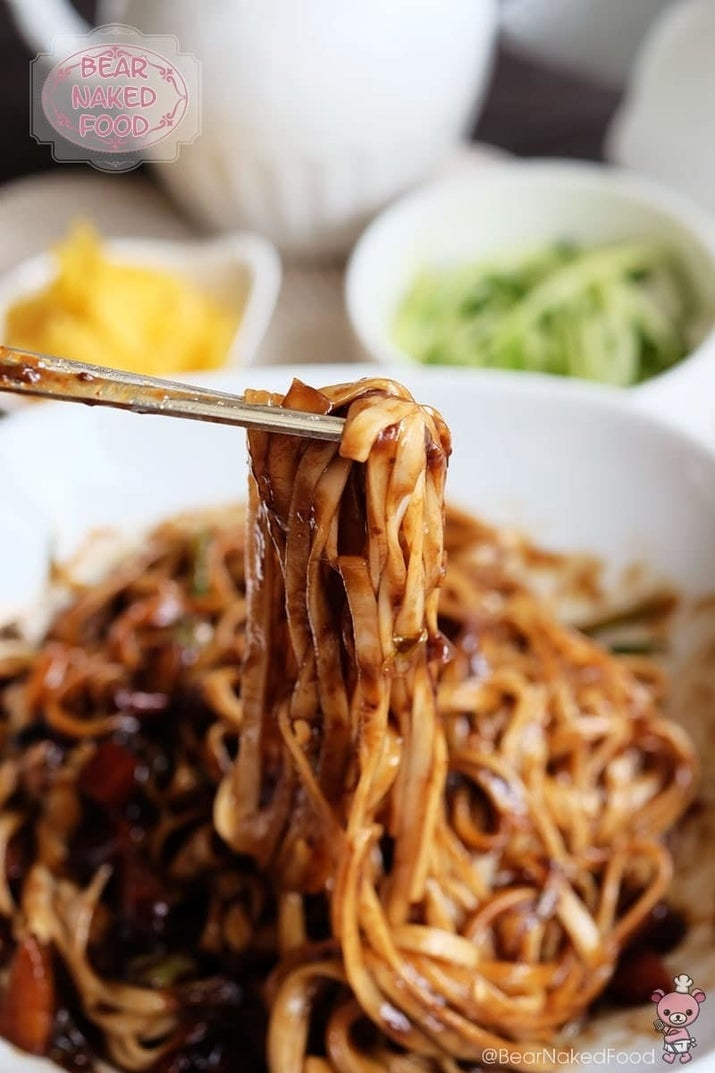 What is it? Noodles in black bean sauceChewy noodles and greasy black sauce are a match made in noodle heaven. In fact, though Chinese in origin, this dish is the most popular takeout item in Korea, and as loved among Koreans as kimchi. Recipe here.