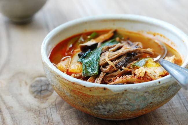 What is it? Spicy shredded beef stewDon't worry, yukgaejang is not as spicy as its scary red color might suggest. In fact, it's considered a comfort food and is a staple dish in every Korean home. Recipe here.