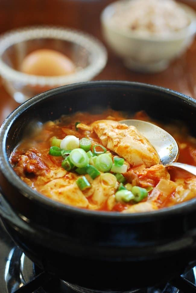 What is it? A stew made with extra soft tofu cubes. Think of this as the Korean version of late night pizza. Filled with either beef, pork, seafood, or kimchi, as well as tender tofu, this spicy dish is a go-to order to after a night of heavy drinking. Recipe here.