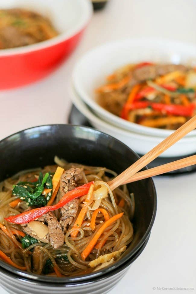 What is it? Sweet potato noodles stir-fried with vegetables and meat.It's most often served as a side dish, though enough additions of beef, mushrooms, sprouts, and other vegetables could bump it up to main course status. Recipe here.